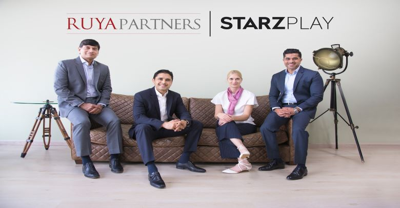 Representatives from Ruya Partners and STARZPLAY pose for a picture.