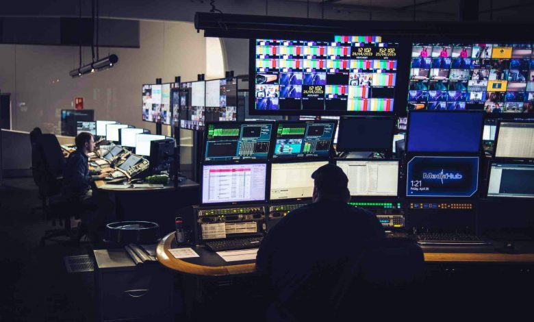 People in a control room.