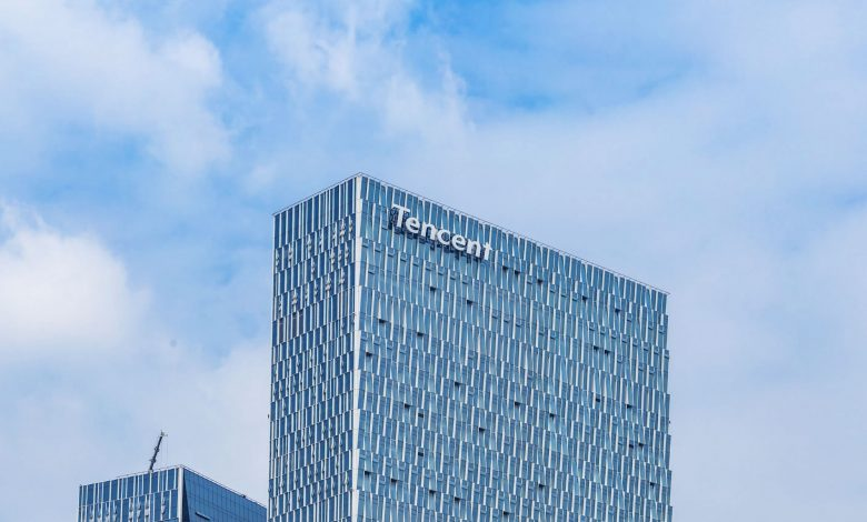 Tencent building, with brand name showing, against clear blue sky for backdrop.