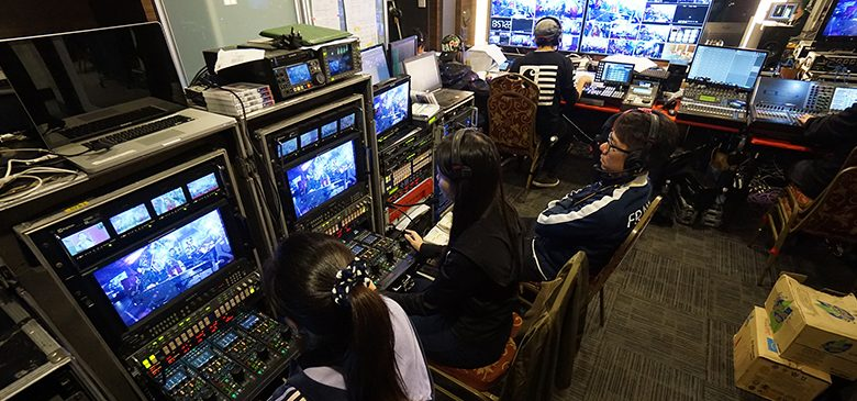 People in a production room