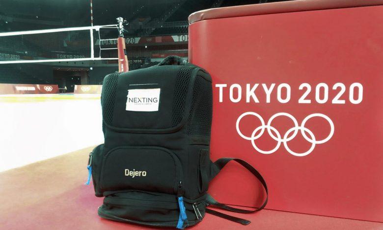 Image of a bag labelled Dejero in front of a platform labelled Tokyo 2020