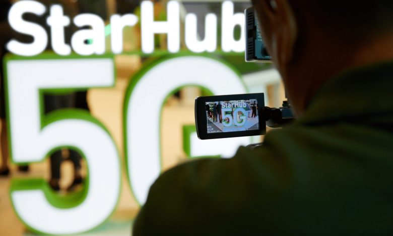 Man filming picture of StarHub 5G logo