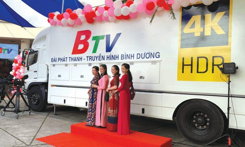 Four women standing in front of a BTV van