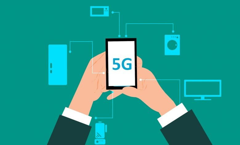 Image of hands holding phone with 5G on screen