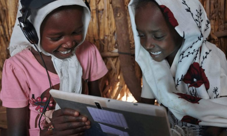 Two African children using a tablet